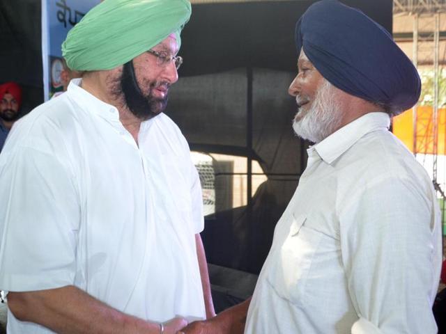 Capt Amarinder Singh meeting his ex-colleague Balbir Singh after 53 years at Samrala near Ludhiana on Saturday.