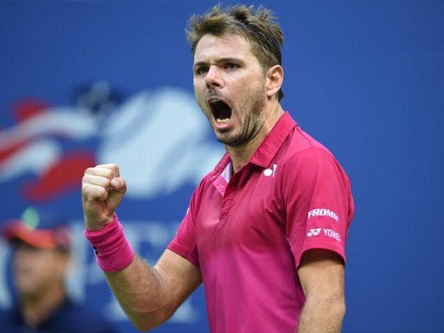 Stan Wawrinka of Switzerland wins a game against Novak Djokovic of Serbia.