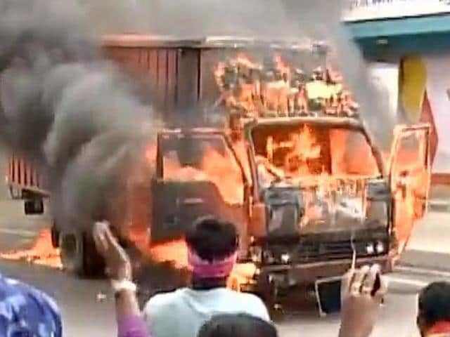 Protesters set fire to a bus in Bengaluru on Monday amid a dispute over River Cauvery water between Karnataka and Tamil Nadu.
