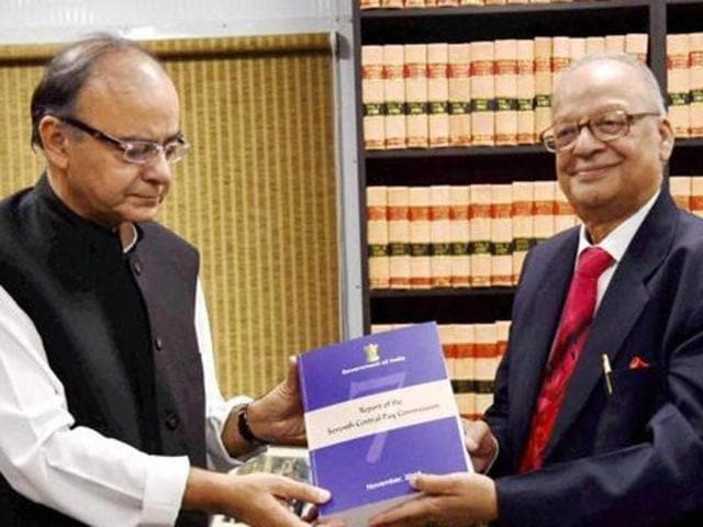 Finance minister Arun Jaitley receiving the report of the Seventh Pay Commission from its chairman justice AK Mathur in New Delhi on Thursday. (PTI)