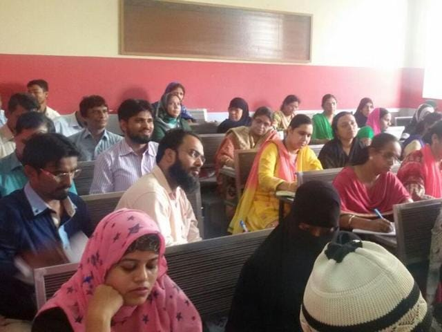 A file photo of people studying at Urdu cultural centre, which was once a Mumbai cultural landmark and now has been shut down.