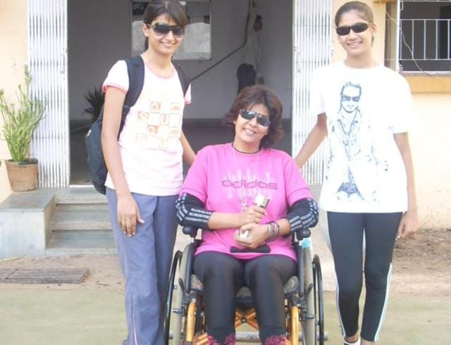 Deepa Malik, seen with her daughters, overcame her handicap caused by cancer, becoming the first Indian woman to win a medal at the Paralympics. Deepa won silver in the shot put F-53 division on Monday.(HT Photo)