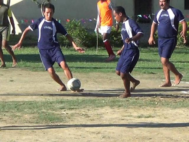 Inmates of the Golaghat district jail play football inside the jail premises.