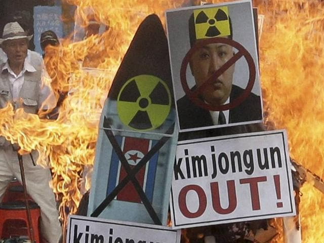 A defaced image of North Korean leader Kim Jong Un is burned by South Korean protesters during a rally denouncing North Korea's latest nuclear test, in Seoul.