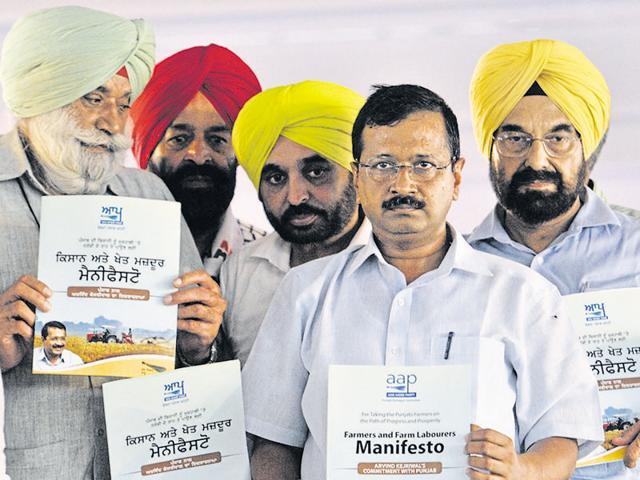 Aam Aadmi Party convener Arvind Kejriwal releasing the farmers' manifesto during a rally at Baghapurana near Moga on Sunday. Also seen are Sangrur MP Bhagwant Mann (centre) and party's 'Bolda Punjab' initiative head Kanwar Sandhu (extreme right).