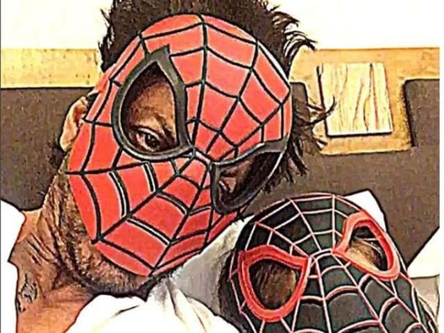 Shah Rukh Khan poses as 'red Spiderman' while his son AbRam is 'black Spiderman'.