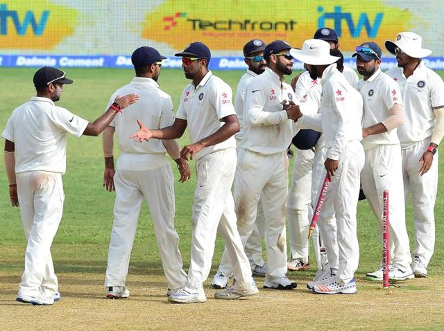 Indian players congratulate one another at the end of their match against the West Indies.