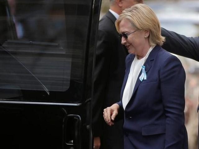 US Democratic presidential candidate Hillary Clinton gets into her van outside her daughter Chelsea's home in New York on September 11. Clinton left ceremonies commemorating the 15th anniversary of the September 11 attacks feeling 'overheated'.