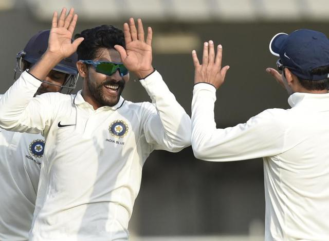 India Blue Bowler Ravindra Jadeja celebrates the wicket of India Red Batsman Stuart Binny during the Duleep Trophy final in Greater Noida on Monday.