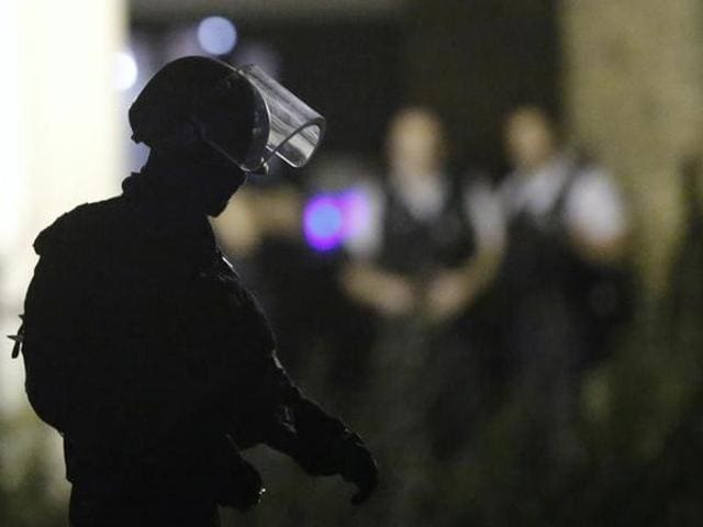 French policemen take part in a police raid in Boussy-Saint-Antoine near Paris, France.