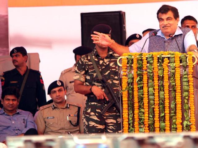Union transport minister Nitin Gadkari addresses a gathering after laying the foundation stone of three underpasses on the Gurgaon Expressway on Sunday.