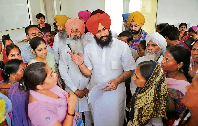 Independent MLAs Simarjeet and Balwinder Bains meeting people at their office in Ludhiana.