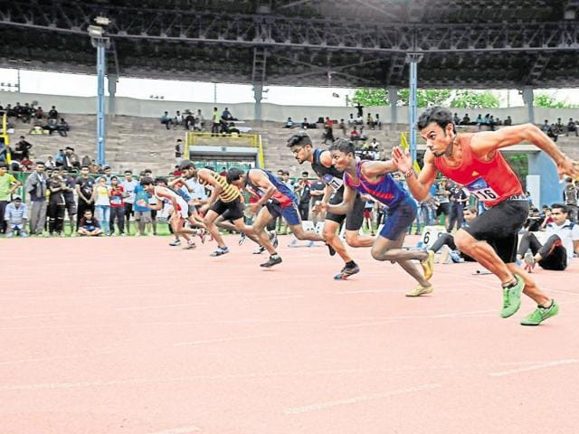 Athletes in action during men's 100-metre race at the 56th inter-district athletics championship at Tatya Tope Stadium in Bhopal recently.