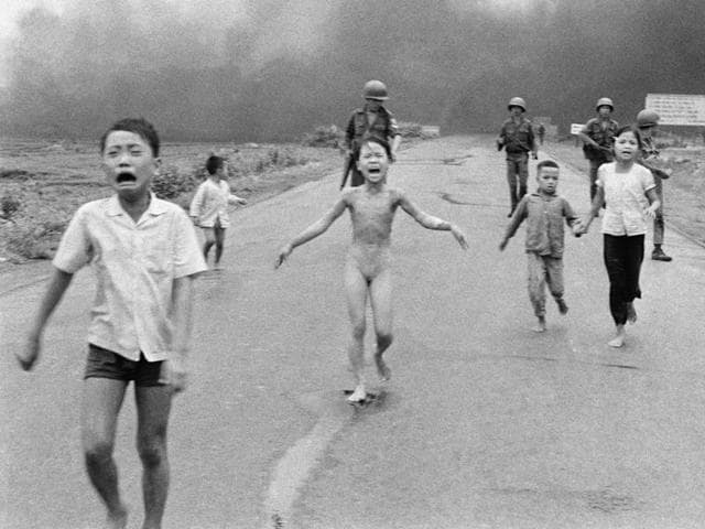 FILE - This is a June 8, 1972 file photo of South Vietnamese forces follow after terrified children, including 9-year-old Kim Phuc, center, as they run down Route 1 near Trang Bang after an aerial napalm attack on suspected Viet Cong hiding places .