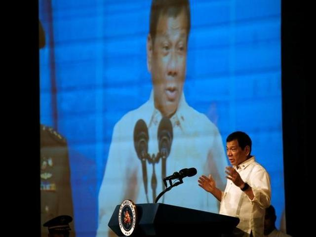 Philippine President Rodrigo Duterte delivers his pre-departure message before leaving for the ASEAN Summit in Laos at Davao International Airport on September 5.