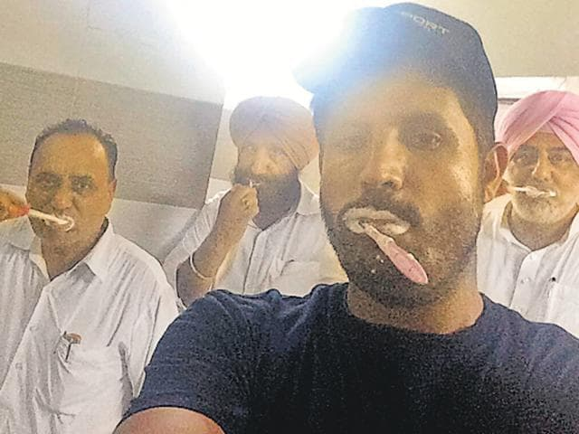 From left: Congress MLAs Tarlochan Singh Soondh, Sukhjinder Randhawa, Amrinder Singh 'Raja' Warring and Randeep Singh brushing their teeth in the assembly washroom on Tuesday morning after an overnight stay by the party's legislators in a protest at the Punjab Vidhan Sabha.