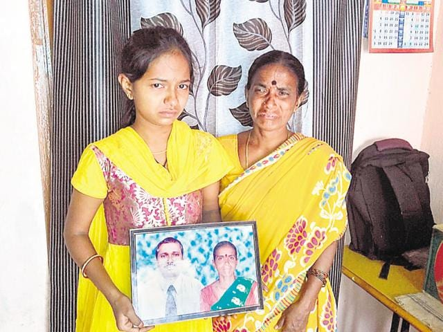 Daughter (left) and wife of Marampalli Naryana who has been jailed in Kuwait for taking up part time work. The family lives in Indalwai village of Nizamabad and are unable to help Naryana.