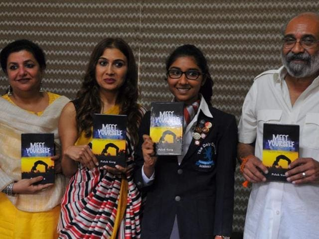 """Palak Garg (second from right) releases her book """"Meet Yourself"""" at Daly College in Indore on Monday."""