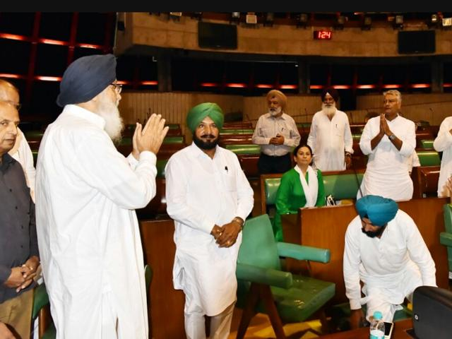 Punjab CM Parkash singh Badal meeting the protesting Congress MLAs inside the Punjab assembly on Tuesday.