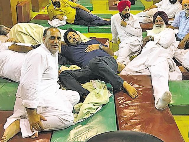 Congress MLAs sent this picture to HT showing themselves set to sleep again in the House, at 11pm on Tuesday.