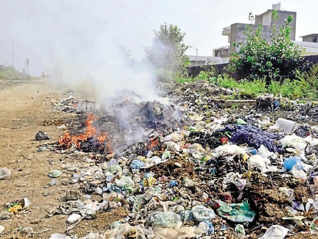 Garbage dumped by residents in an open space near the railway crossing at Verka in Amritsar.