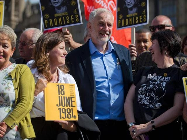 British Labour party Leader Jeremy Corbyn (Centre) stands with campaigners outside the Houses of Parliament in central London on Tuesday.