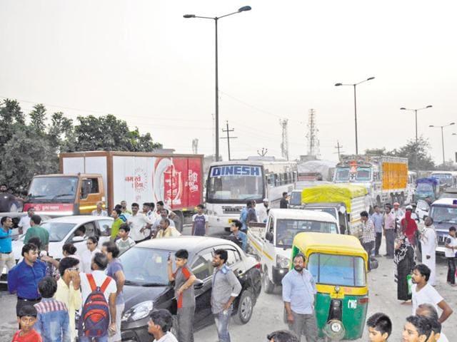 Bheem Nagar residents block NH-24 near Vijay Nagar after Prem Wati, 60, and her grandson, 25, were shot dead.