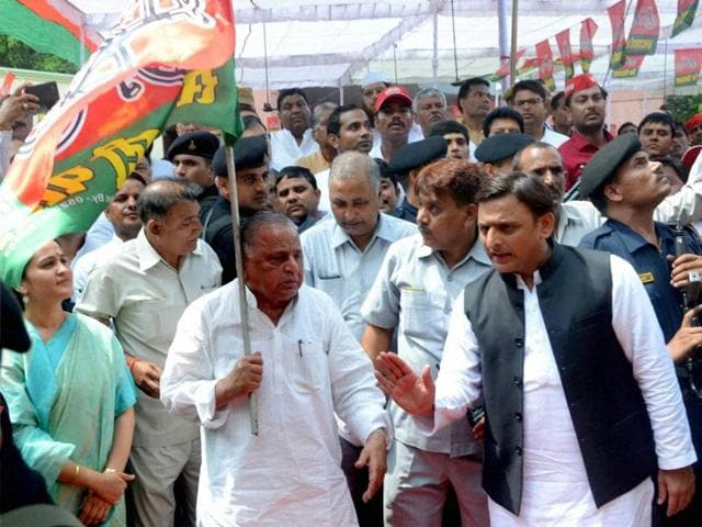 Samajwadi Party supremo Mulayam Singh Yadav and Uttar Pradesh chief minister Akhilesh Yadav at an event in the Lucknow party office.