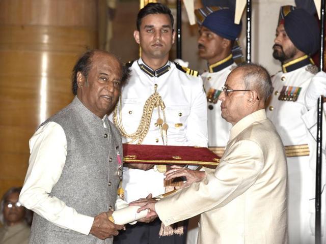 Actor Rajinikanth receives Padma Vibhushan from President Pranab Mukherjee during Padma Awards ceremony at Rashtrapati Bhawan.