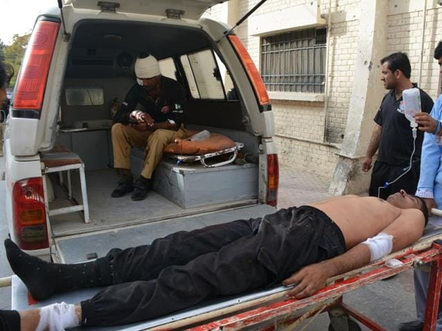 Injured Pakistani policemen arrive at a hospital following a bomb explosion in Quetta.