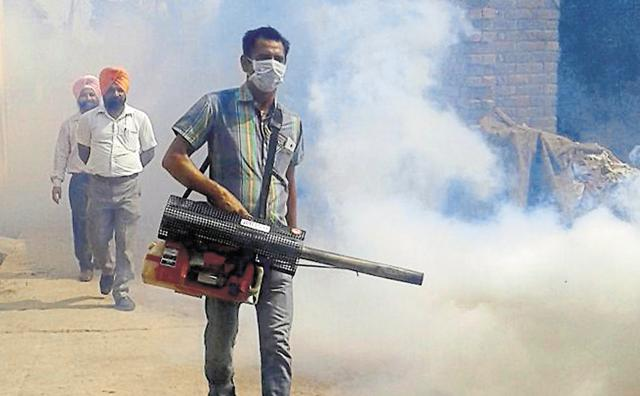 A worker undertaking fogging at a locality in Patiala on Monday.