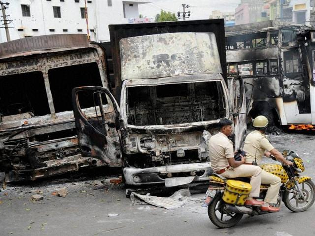 Charred remains of the vehicles in Bengaluru on Tuesday, a day after they were torched by pro-Kannada activists during their violent protests over Cauvery water dispute.