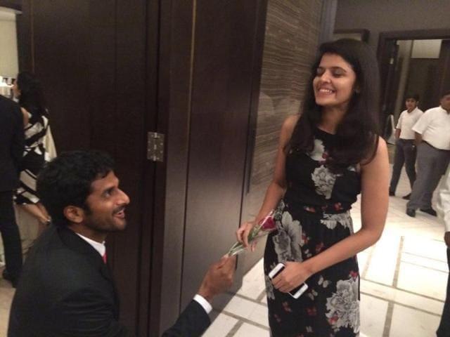 Myneni gets down on one knee to propose to Sri Lakshmi.
