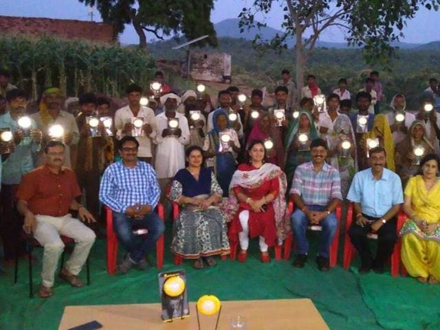 Indore forest department distributed solar lights to villagers of Nahar Jhabua on Monday.