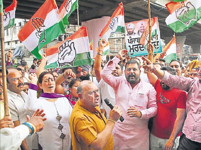 Congress workers protesting in Ludhiana on Tuesday.