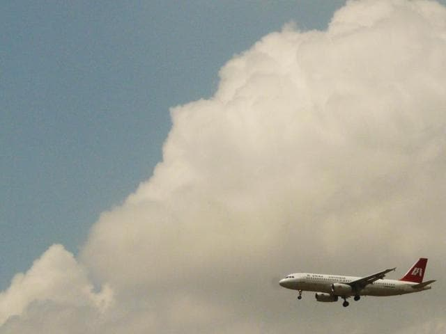 An Indian Airlines plane in the sky over Delhi. Some pilots of the airline, which was merged into Air India, were sacked after a strike. Now they want to rejoin duty