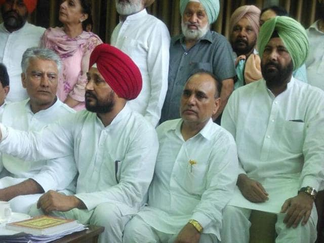 Congress MLA Tirlochan Singh Soondh (without shoes), who hurled his shoe at the Akali MLA, holding a press conference in Chandigarh on Wednesday.