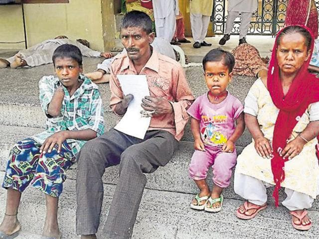 Family of bonded labourer Sewak Ram, who were allegedly victimised by SAD leader, in Tarn Taran on Tuesday.