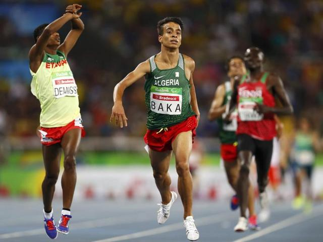 Abdellatif Baka of Algeria (C) wins gold in the men's 1500m T13 final ahead of Tamiru Demisse of Ethiopia (L), who won the silver.