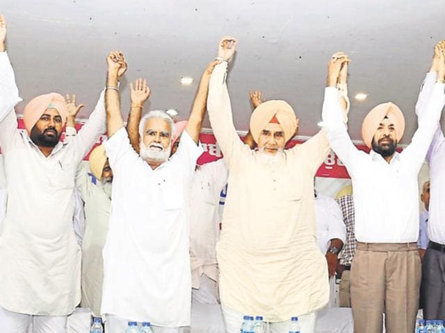 Sacked Punjab AAP convener Sucha Singh Chhotepur (fourth from left) and his supporters raise hands during a rally in Bathinda on Tuesday.