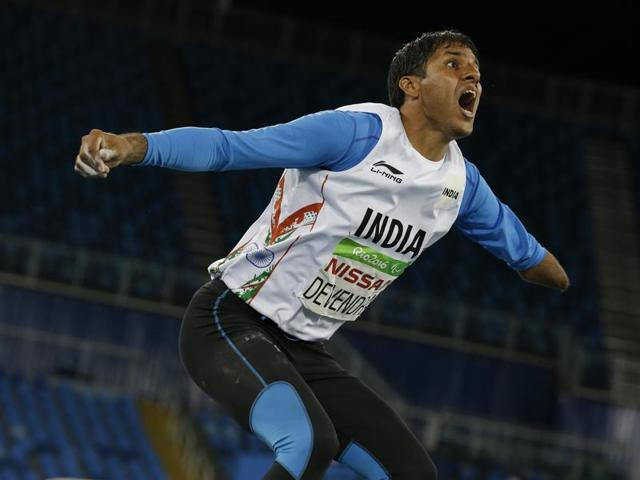 Devendra Jhajharia poses next to the scoreboard that shows his world record in the men's javelin throw F46 athletics event at the Paralympic Games in Rio de Janeiro.