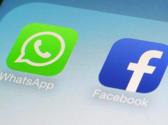 This file photo shows WhatsApp and Facebook app icons on a smartphone in New York.