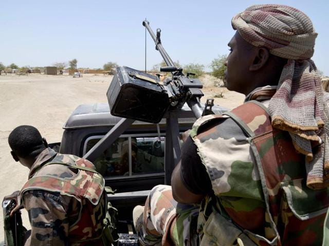 Nigerien soldiers patroling on a road between Diffa and Bosso.