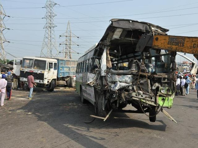 Mangled remains of the ill-fated bus being removed from the accident spot on the Jalandhar-Amritsar national highway in Jalandhar on Wednesday.