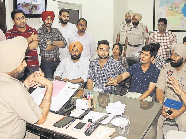 Atul Gupta (in blue T-shirt), father of Atharva, recording his police statement in Ludhiana on Tuesday.
