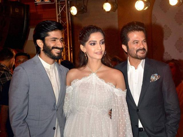 Harshvardhan Kapoor with his sister and actor Sonam Kapoor, his father and actor Anil Kapoor during the music launch of film Mirzya in Mumbai.