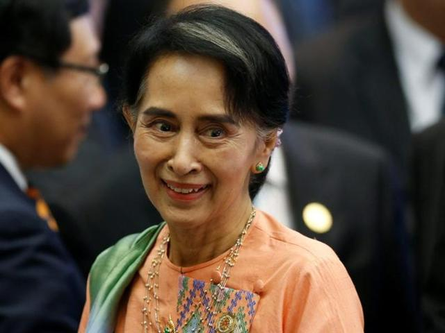 Myanmar's State Counsellor Aung San Suu Kyi arrives at the ASEAN-India Summit in Vientiane, Laos September 8, 2016. REUTERS/Soe Zeya Tun/File Photo