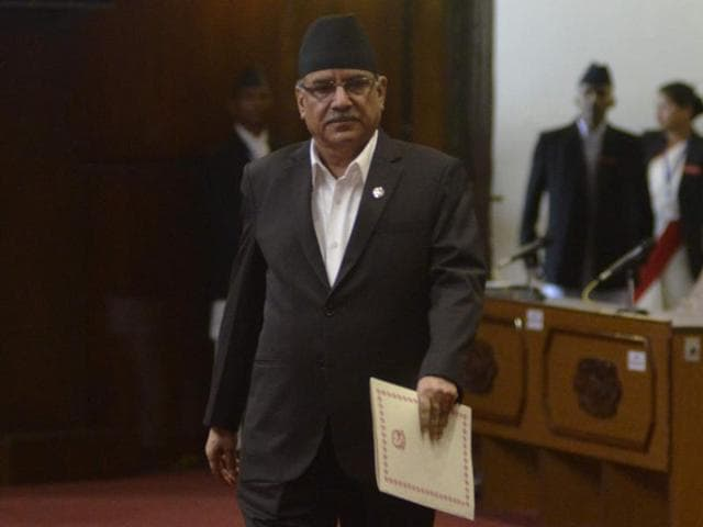 Nepalese Prime Minister Pushpa Kamal Dahal, also known as Prachanda, walks before addressing Parliament in Kathmandu.