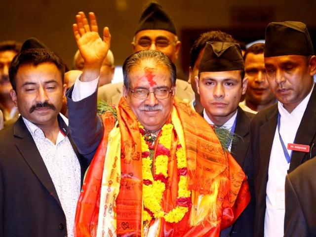 "File photo of Nepal Prime Minister Pushpa Kamal Dahal ""Prachanda"" waving towards the media after he was elected in August."