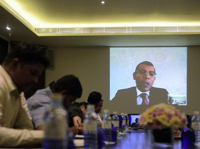 In this photograph taken on Tuesday, exiled Maldives opposition leader Mohamed Nasheed addresses Sri Lanka-based foreign correspondents via video link in Colombo. Nasheed has said he is in talks with the former president who repeatedly threw him in jail to